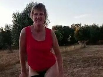 Granny outside peeing
