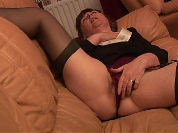 Horny granny in stockings showing off her mature hairy pussy