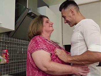 Big fat granny takes young cock