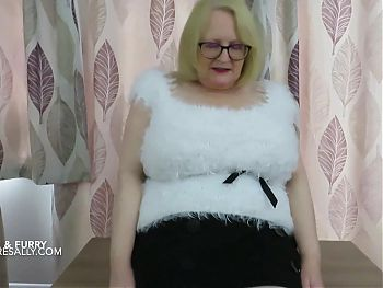 Sallys huge tits in her white furry top
