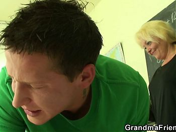 Very old blonde teacher punish two students